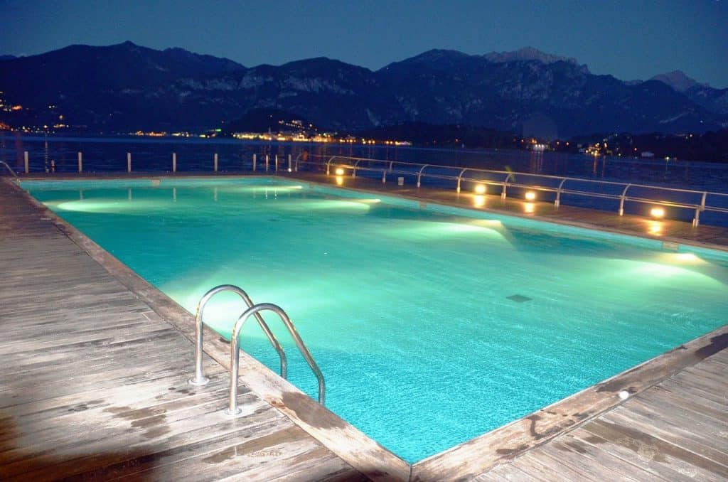 a pool with its lights on at night