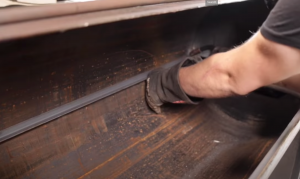 placing angle iron in the oil tank smoker for the shelves
