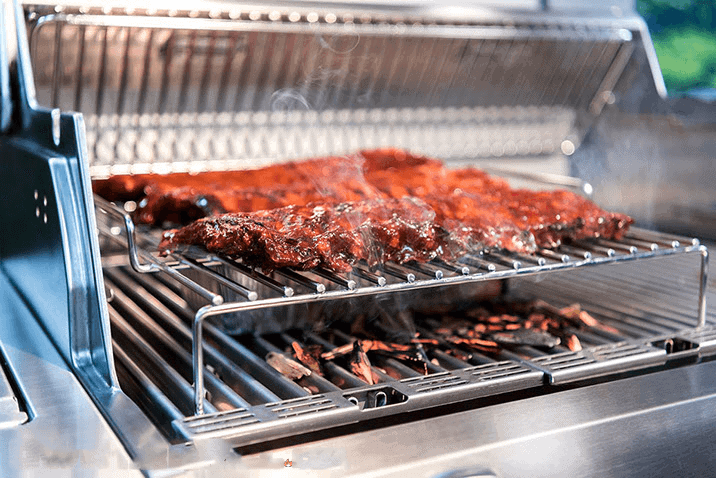 A Infrared Grill cooking a couple racks of ribs