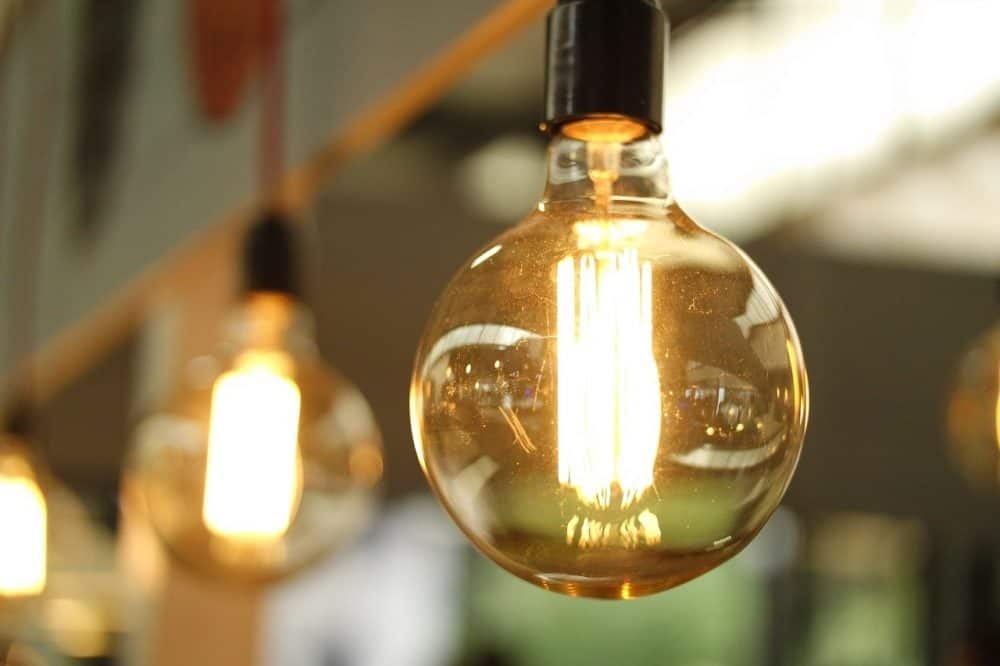 a light bulb to show how energy efficient infrared grills can be.