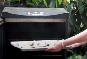 putting oysters in a smoker