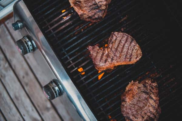 steaks cooking at the right temperature on a pellet grill