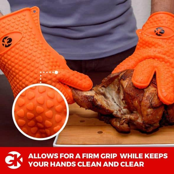 Silicone grilling gloves taking apart meat
