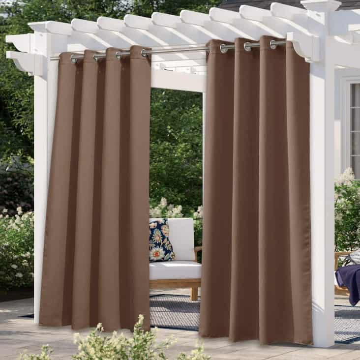 stylish curtains to provide outdoor shade in the backyard patio