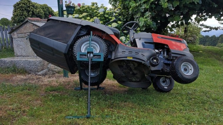 a jacked up mower for removing a stuck lawn mower wheel