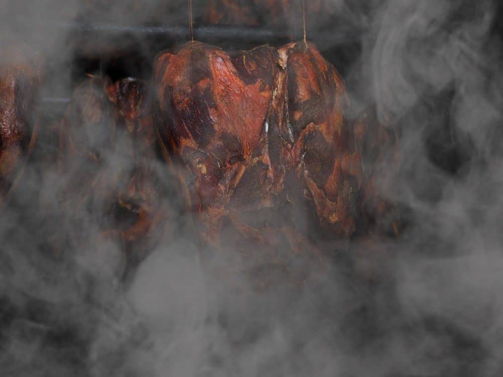 a raw ham smoking
