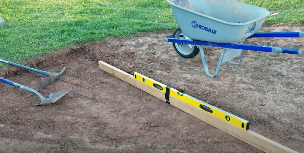 a board and level for putting in a pool without digging