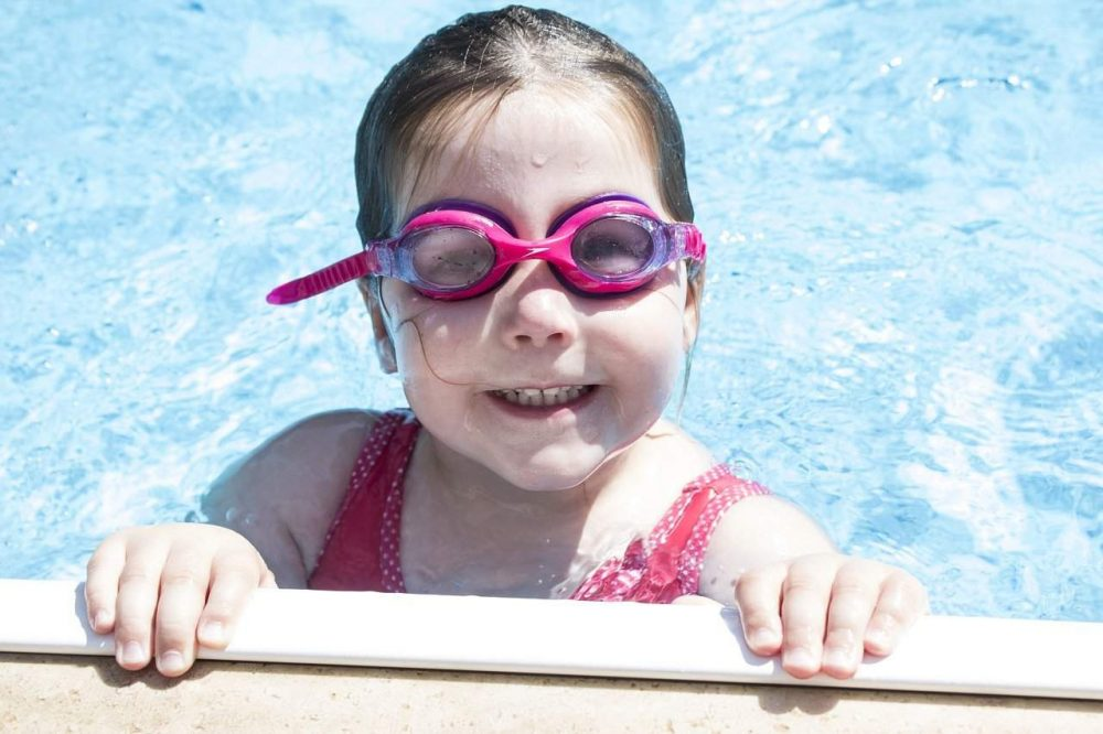 a young girl in a swimming pool