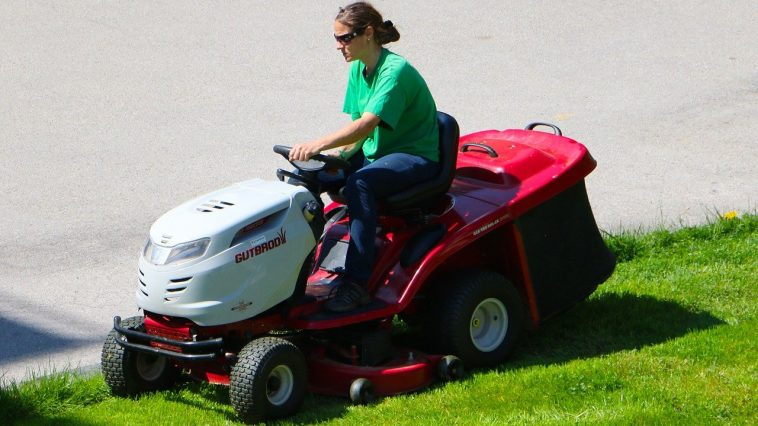 riding a fast lawn mower