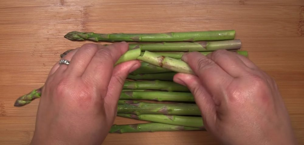 snapping off woody end of asparagus before smoking
