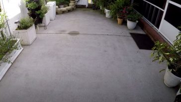 a concrete patio cleaned without a pressure washer