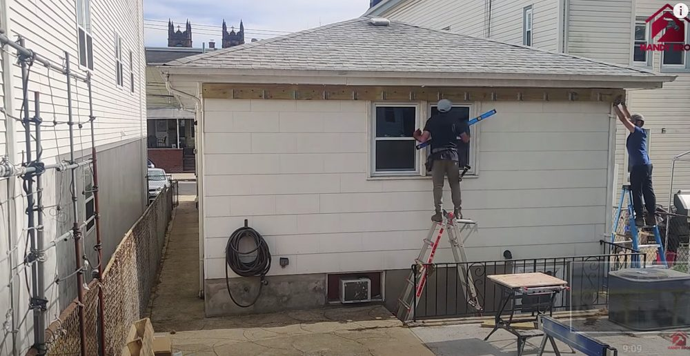 installing the ledger board for the patio cover