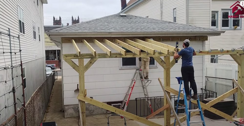 installing the rafters on the patio cover with metal roof