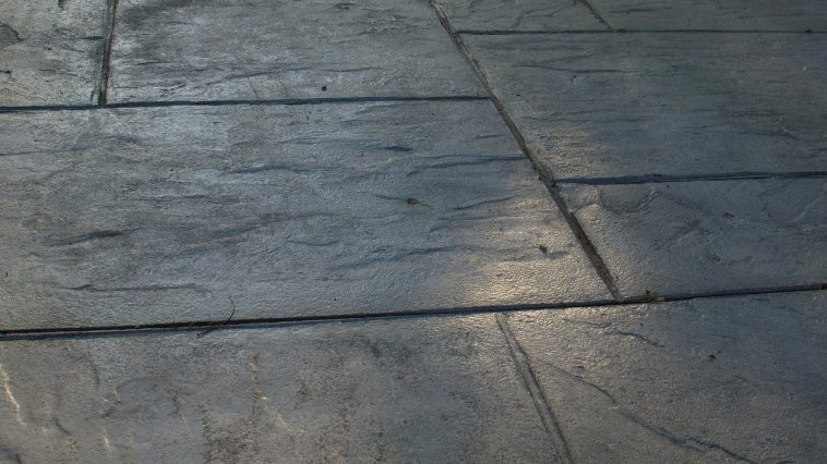 a patio that slopes for drainage