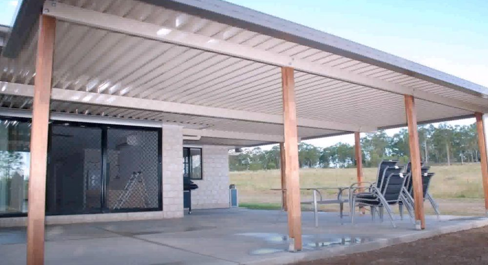 a patio cover with a corrugated metal roof