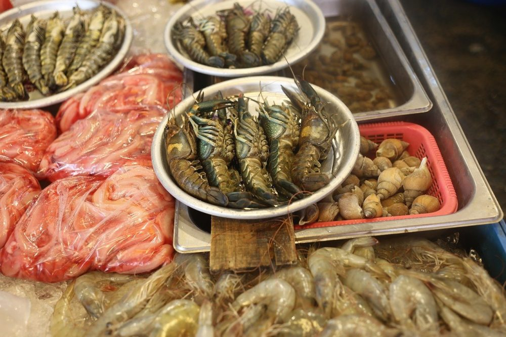 seafood market with lobster tails for sale