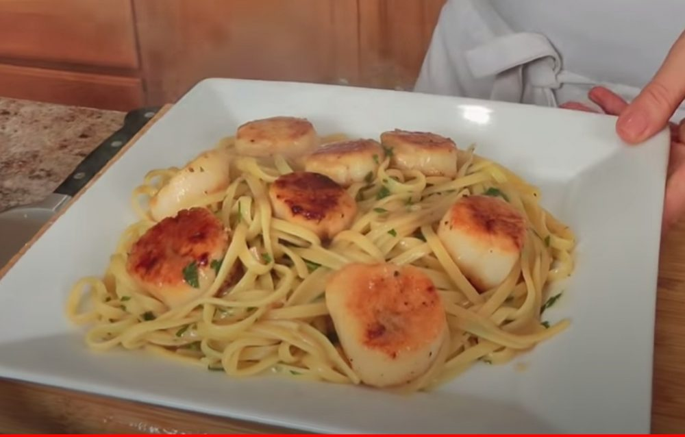 large smoked sea scallops served over linguine on a plate