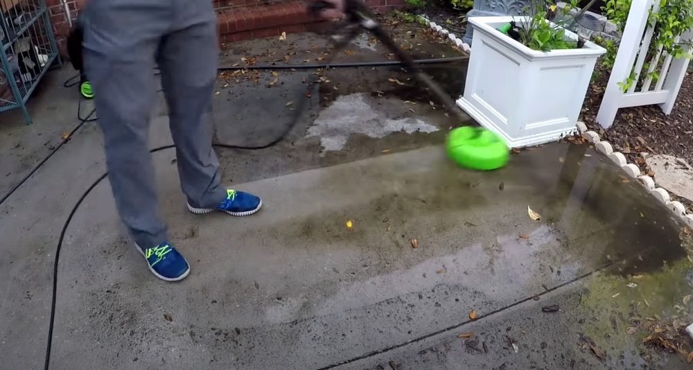 another sun joe cleaning a concrete patio without a pressure washer