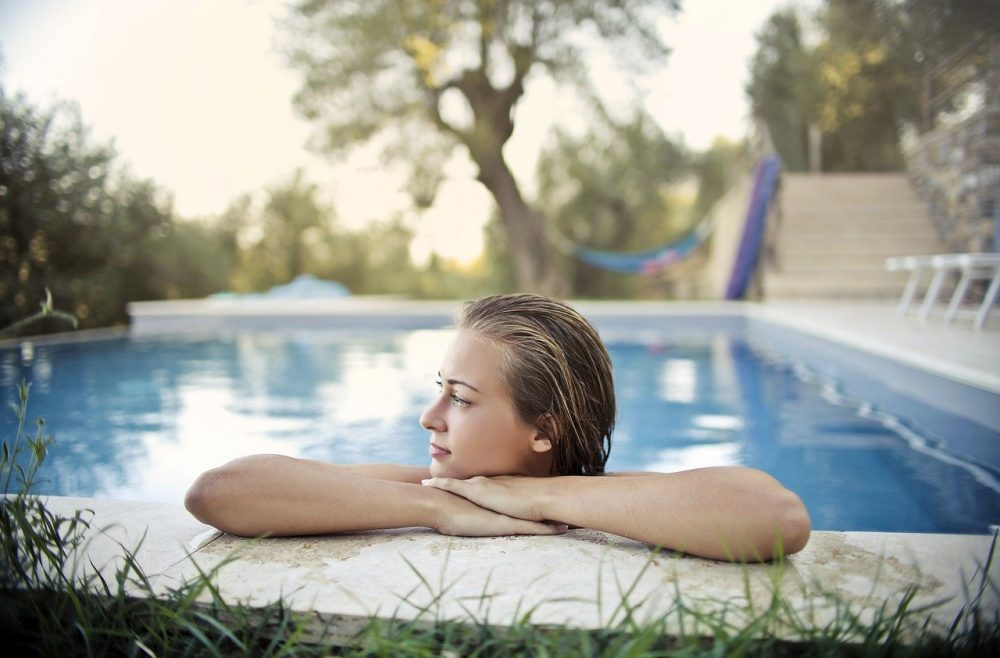 a woman swimming in a just opened pool