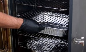 setting up elctric smoker with drip tray for chuck roast