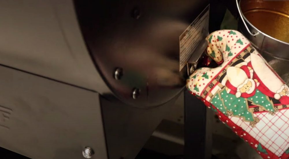 pulling the release lever on a camp chef pellet grill