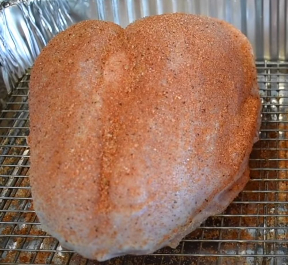BBQ rub on the outside of a turkey breast