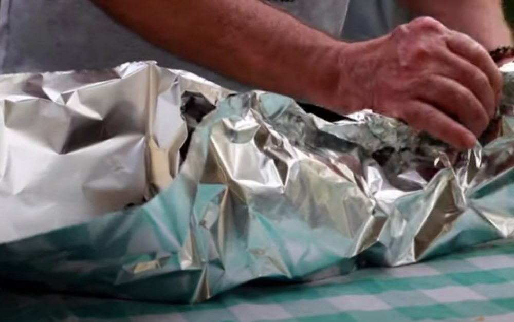 wrapping a smoked chuck roast in aluminum foil
