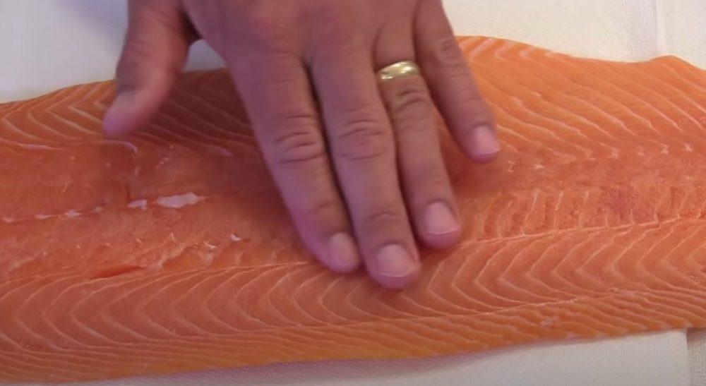 checking for bones in salmon fillet