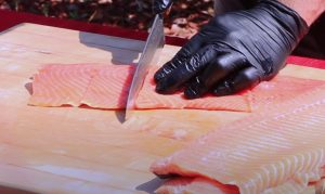 cutting fillets of salmon
