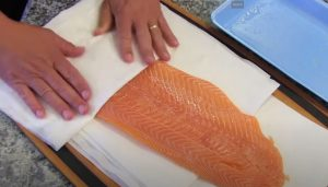 patting dry salmon after rinsing