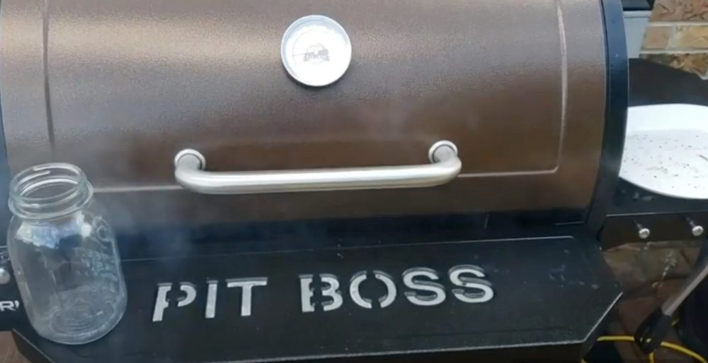 a pit boss pellet grill making smoke and cooking