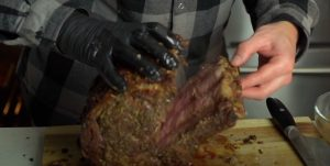 removing the bones from a smoked prime rib