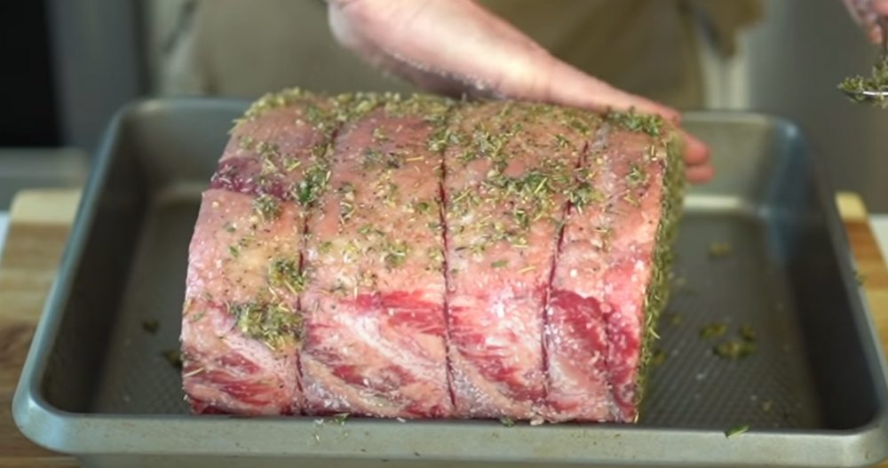 seasoned prime rib going on a traeger grill
