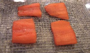 salmon drying on a wire rack
