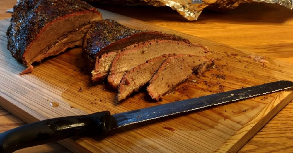 hot and fast brisket cooked on a pellet grill sliced