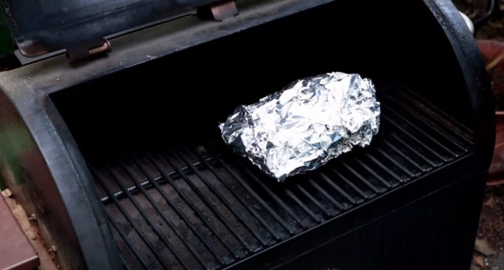 smoked corned beef wrapped in foil on pellet grill