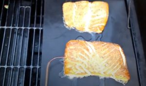 smoked halibut cooking on the grill