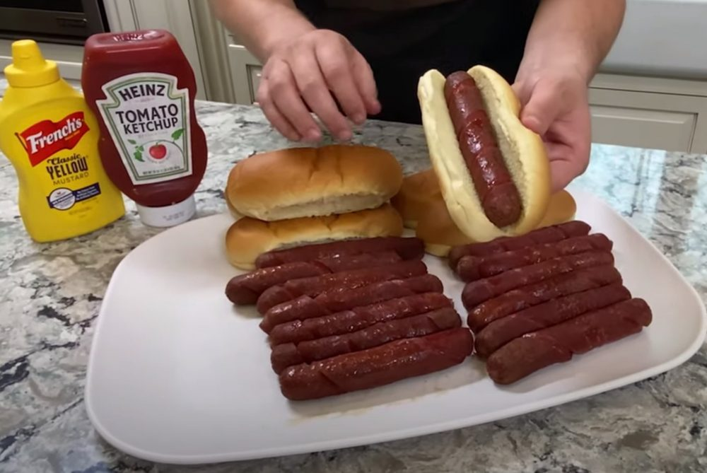 showing off smoked hot dogs