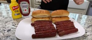 smoked hot dogs on a plate