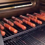 smoked hot dogs on a smoker