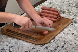 spiral slicing a hot dog for the smoker