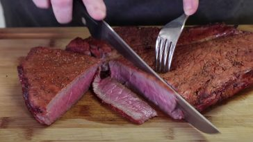 slicing a smoked london broil