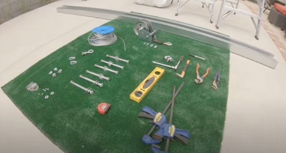 Tools and materials laid out to build a batting cage