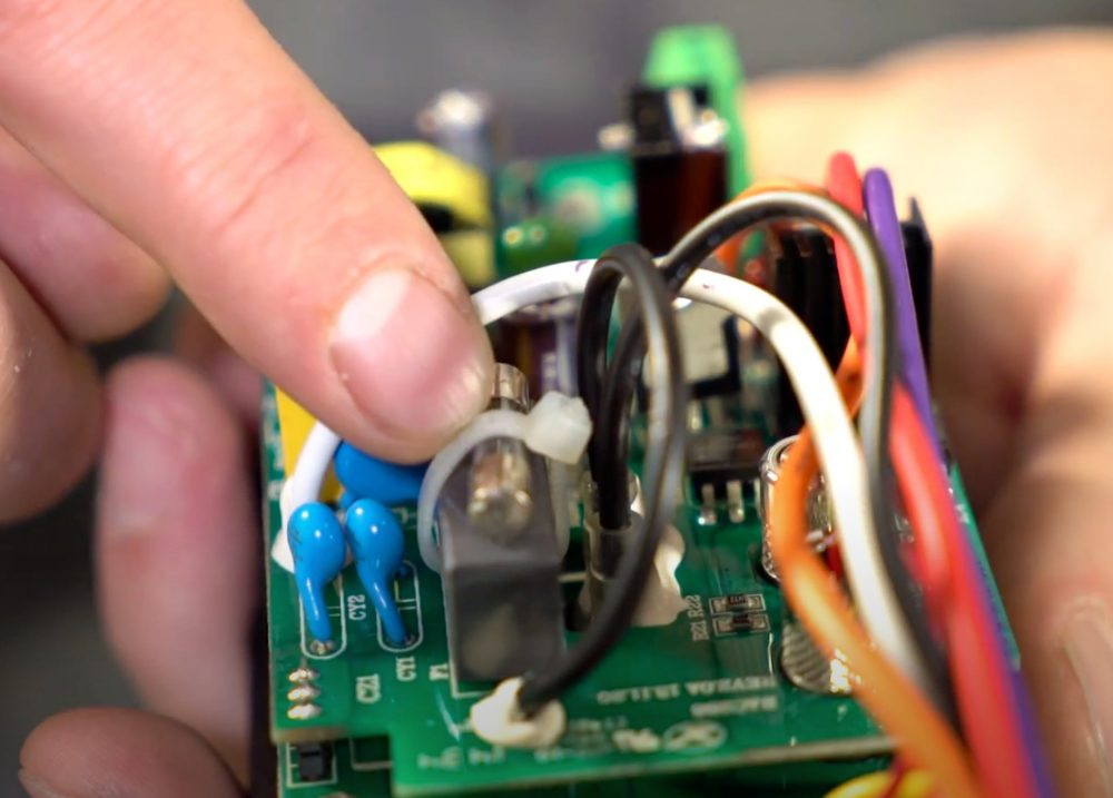 pointing to the fuse on the traeger grill control panel