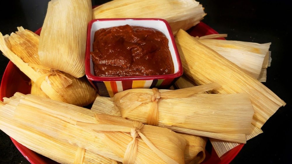 steamed tamales on a plate