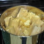 tamales steaming in a pot