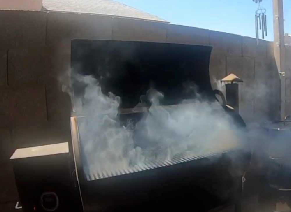 white smoke coming out of a traeger pellet grill