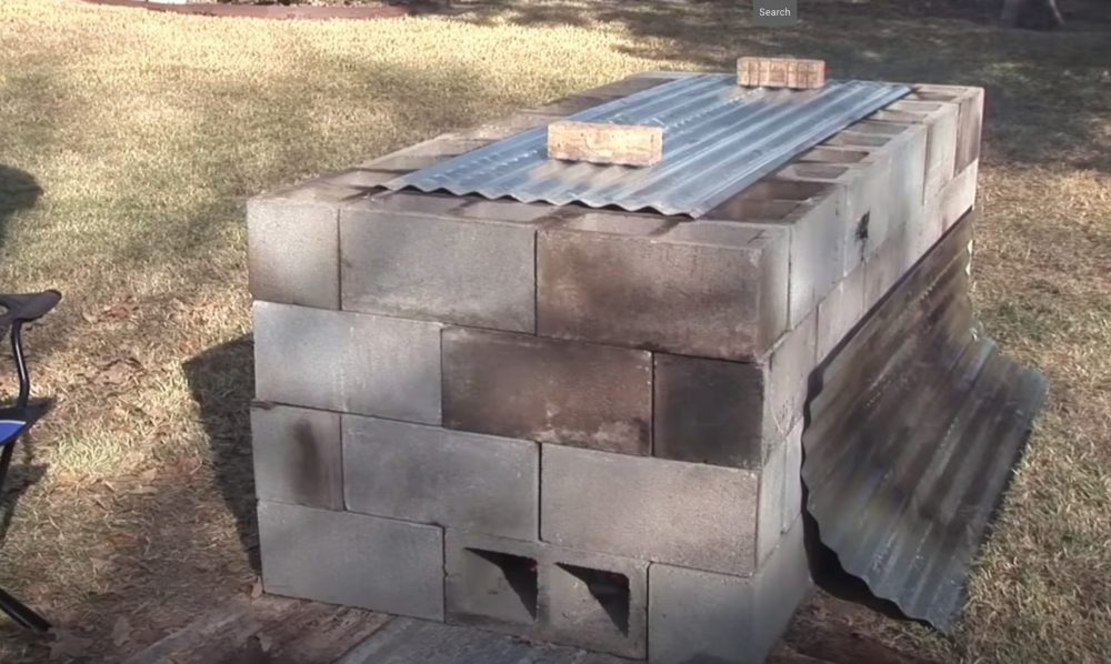 cinder block oven for roasting a pig in a backyard