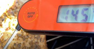 an instant read thermometer reading 145 degrees