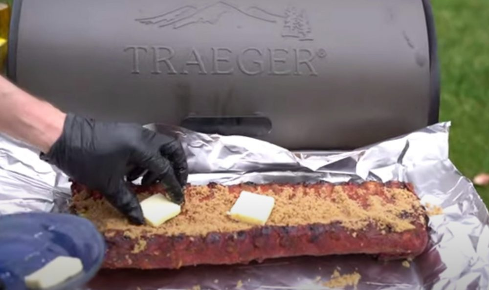 placing butter on the 321 ribs before putting back on the traeger